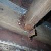 Look carefully at the bottom of the metal joist hanger hardware.  It has completely corroded and failed.  Unfortunately, the chemicals used to treat lumber are corrosive.  It is vital to use corrosion-resistant hardware to support a deck.